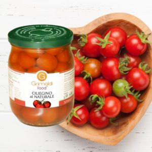 Glass tomatoes and tomatoes in heart-shaped container